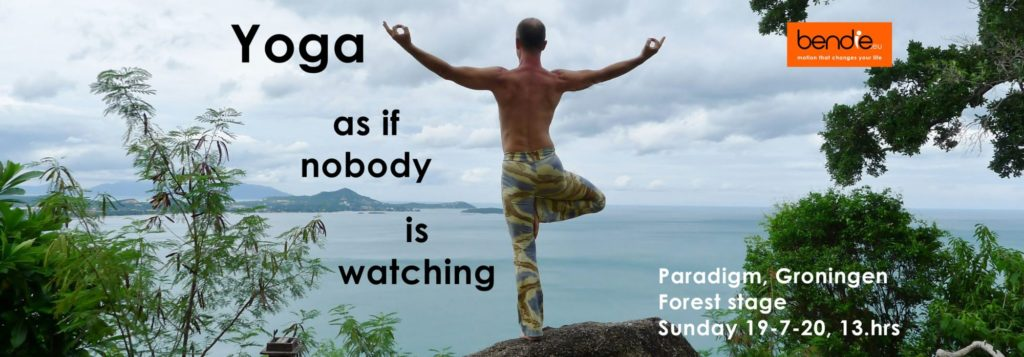 Yoga as if nobody is watching. man in tree pode overlooking the sea