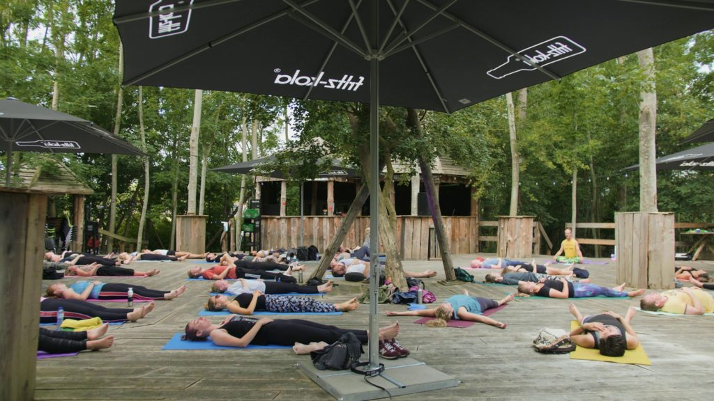 yoga done differently 02-08-20. People relaxing in savasana pose